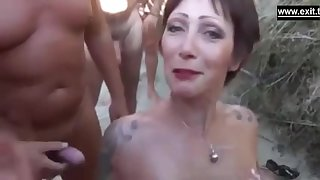 A beautiful French Beach slut sucks one detect after the backup and gets showered with cum.